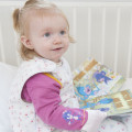 Child-in-cot-wearing-Shruggi_with-books