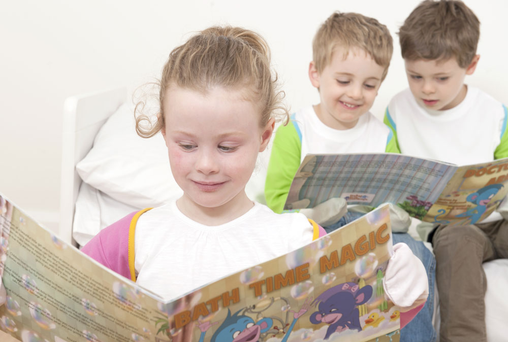 Older-children-reading-stories_looking-at-pictures-themselves-wearing-Shruggi