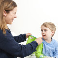 Parent-putting-Shruggi-on-child